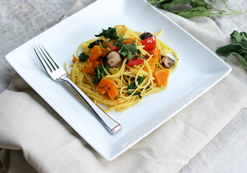 gluten free pasta with butternut squash and kale in a lemon butter sauce
