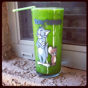 green juice in a tom and jerry glass