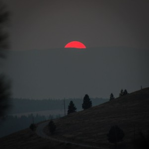 Red sun dipping below the mountains Montana nofilter