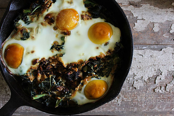 Baked Eggs with Garlic Kale and Sun-Dried Tomatoes